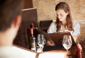 young woman browsing through a menu