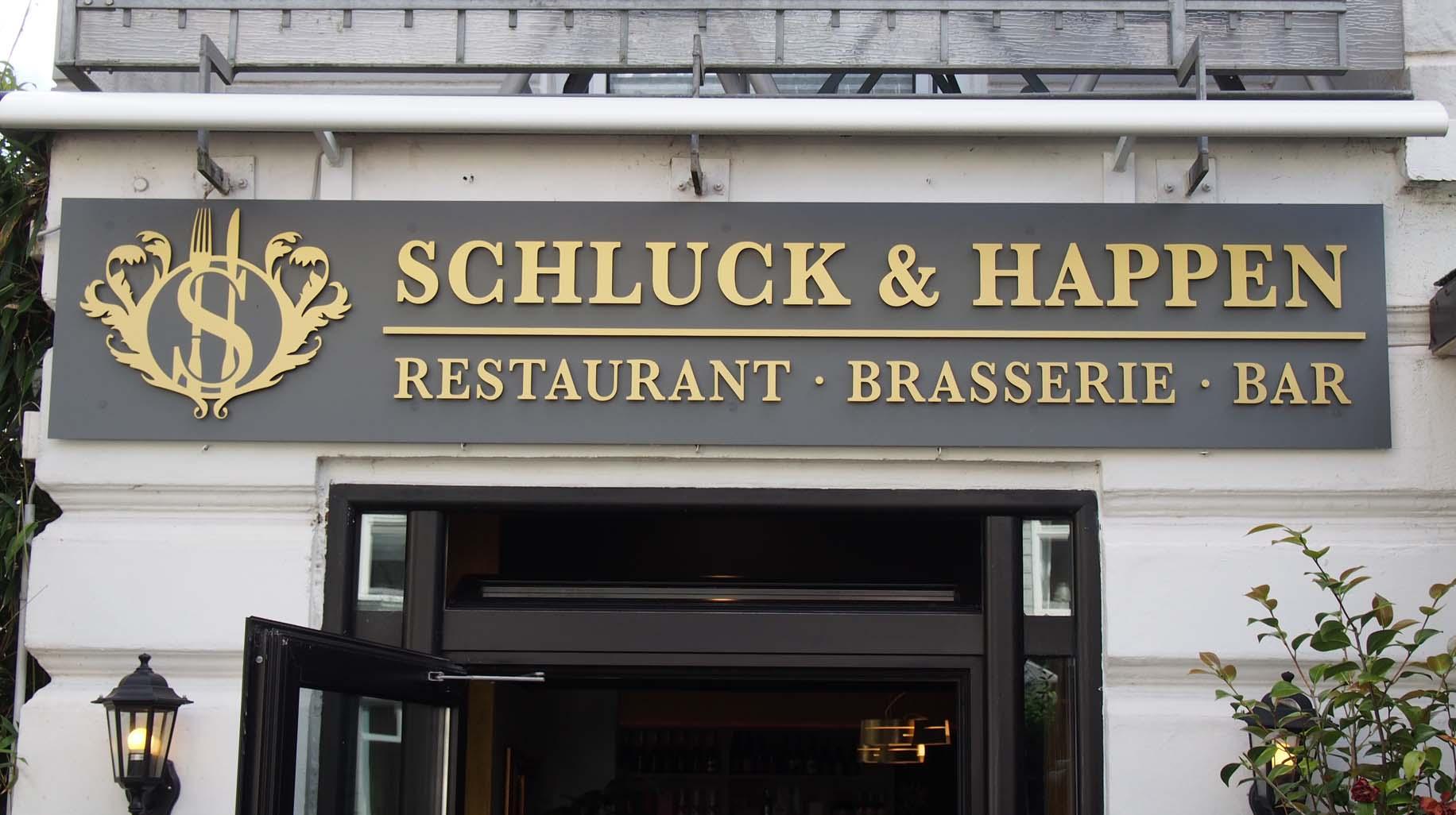 Schluck&Happen Logo